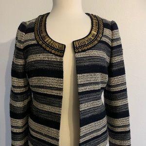 Tweed jacket with beautiful golden details